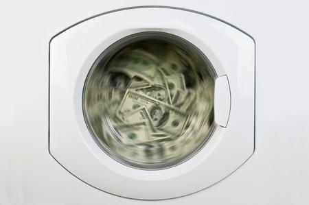 Geld in Waschmaschine close up