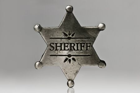 sheriff star isolated on black photo