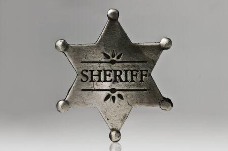 sheriff star isolated on black photo