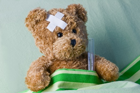 teddy bears: bear in bed with thermometer and plaster