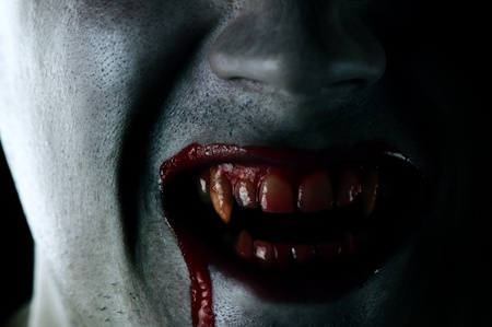 fangs: vampire mouth with blood closeup