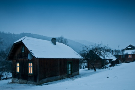 wooden hut: house on village on winter time Stock Photo