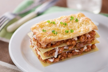 lasagna: piece of lasagna on white plate