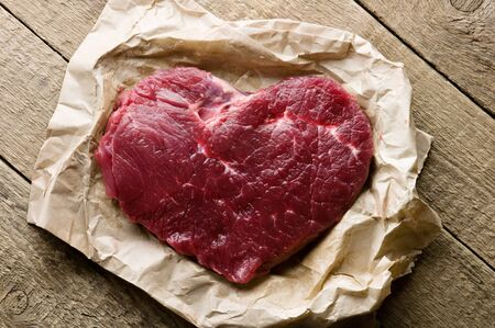 beef cuts: beef heart in paper closeup
