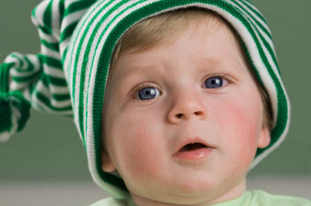 child in hat with blue eyes photo