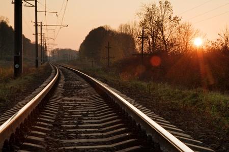 sun track: metal railway and orange sunset