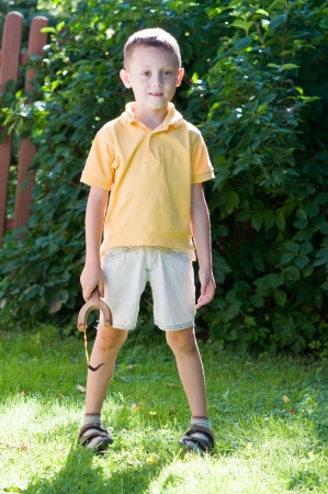 troublemaker: young boy with slingshot shooting