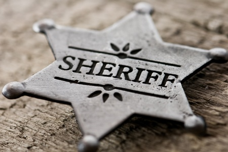western usa: sheriff star isolated on black