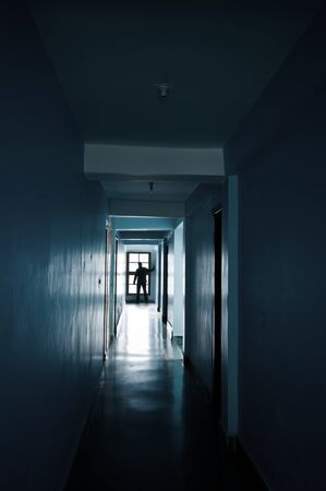 Man silhouette in end of corridor photo