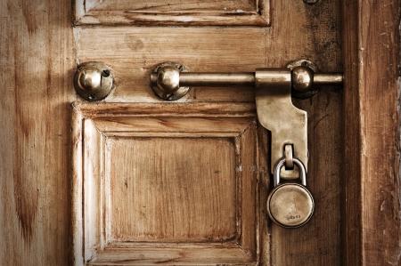 keep gate closed: old door and lock closeup