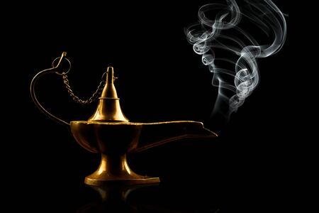 alladin: alladin lamp isolated on black Stock Photo