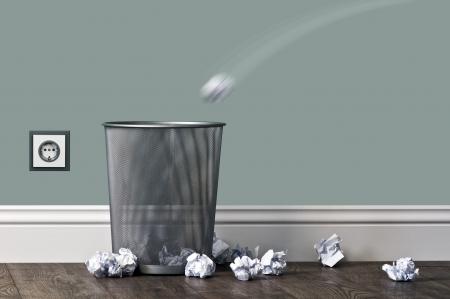 throw paper: office garbage near metal basket