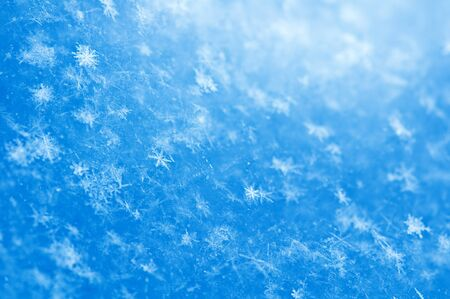 blue snowflakes background close up photo