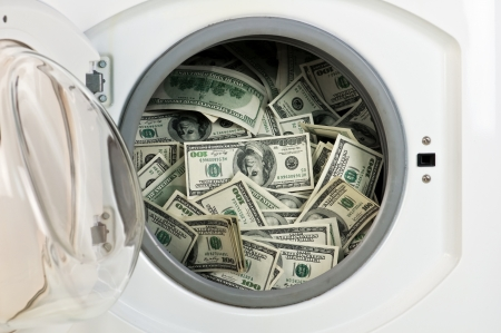 money in washing machine close up photo
