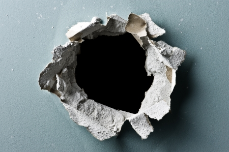 hole in concrete wall closeup