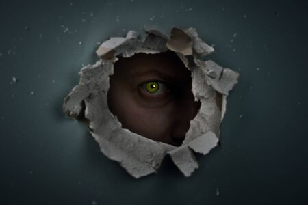hole in the wall: eye behind hole in the wall