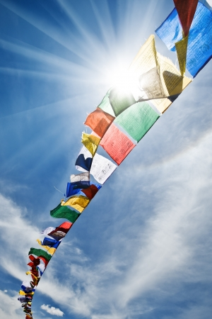 tibetan flags with mantra on sky background Imagens