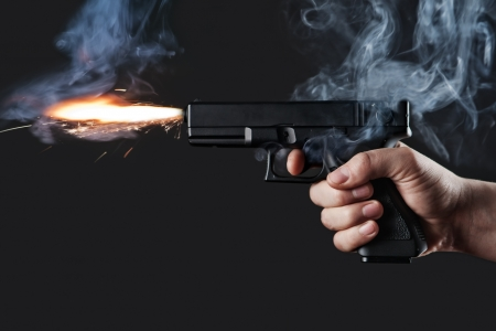 shot from a handgun with fire and smoke Stock Photo