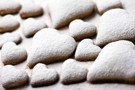 powdered sugar: heart cookie with sugar powder close up Stock Photo