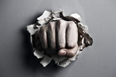 a wall is broken through by a fist Stock Photo - 18180587