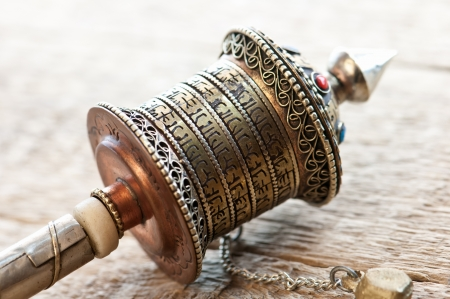 gold tibetan spool on table photo