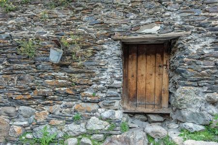 swanetia: old door on caucasus building Stock Photo