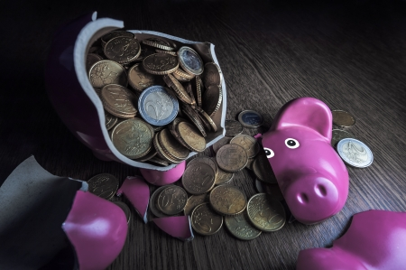 cracked pink pig moneybox closeup photo