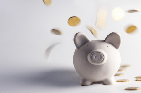 pig money box with golden coins Stock Photo