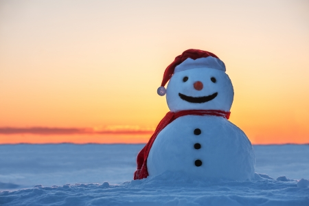 snowman on orange sunset Stock Photo - 22561500
