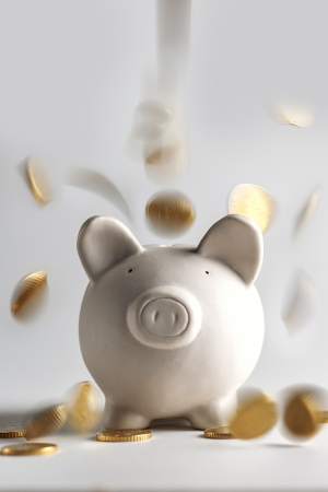 pig money box with golden coins Standard-Bild