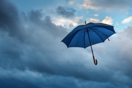 umbrella and cloudy sky closeup