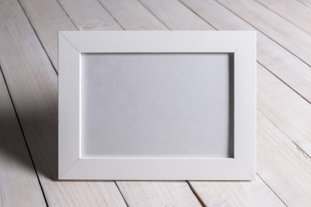 empty photo frame in woman hands