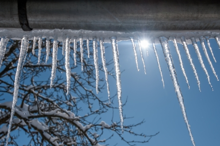 icicles on blue sky background Banco de Imagens