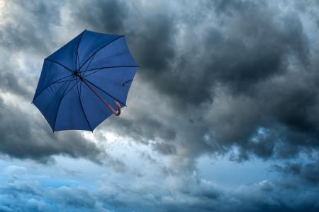 sun umbrella: umbrella and cloudy sky closeup