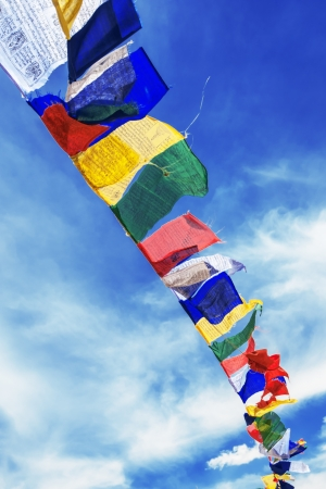 tibetan flags with mantra on sky  Stock Photo