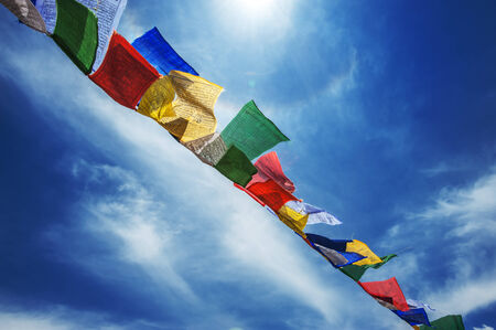 bodnath: tibetan flags with mantra on sky  Stock Photo