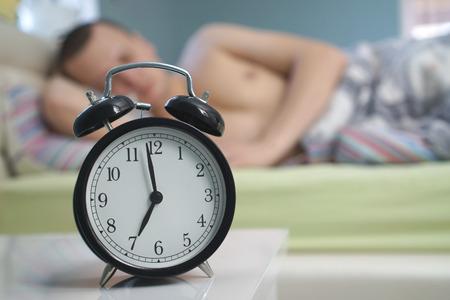 black alarm clock and man photo