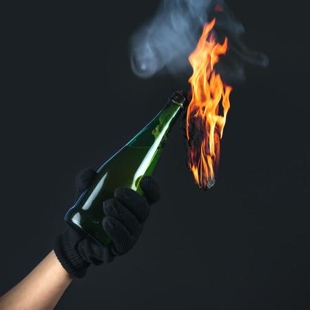 molotov: molotov cocktail in activist hand