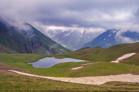 lake in mountain on summer time photo