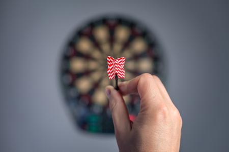 human hand with dart closeup