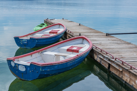 skiff: boats in pier close up