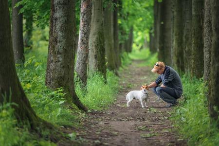 man and dog walking on park Stockfoto