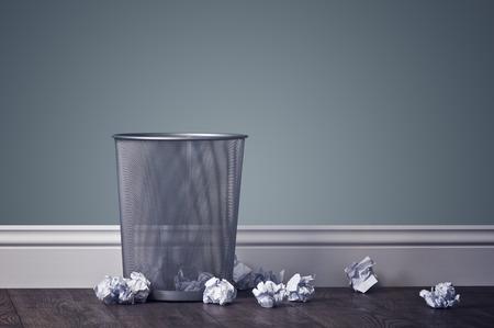paper basket: office garbage near metal basket