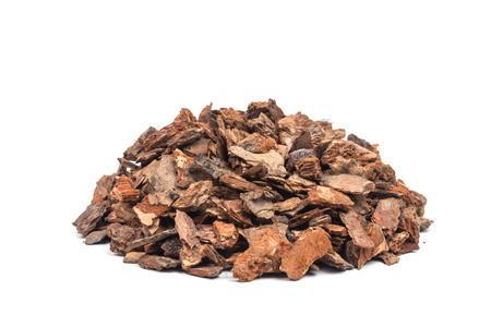 heap of pine bark isolated