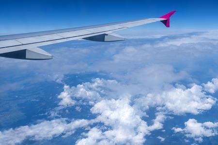 horizon over land: view through airplane window Stock Photo