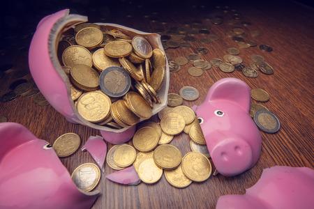 cracked pink pig moneybox closeup photo