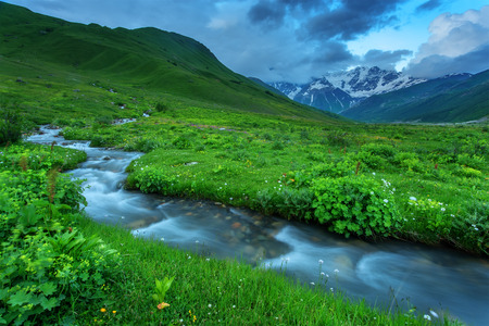 river in mountain on summer time photo