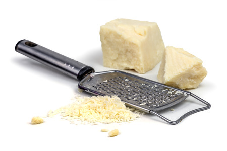 grater: parmesan with grater on wood table