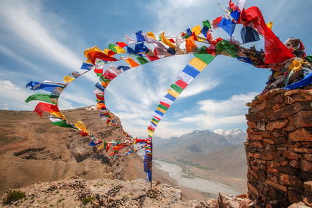 tibetan flags with mantra on sky background Banco de Imagens