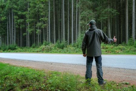 stopping: men stopping car on roadside